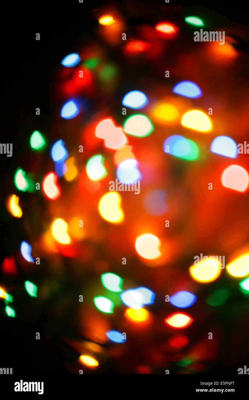 colorful christmas lights out of focus may be used as background