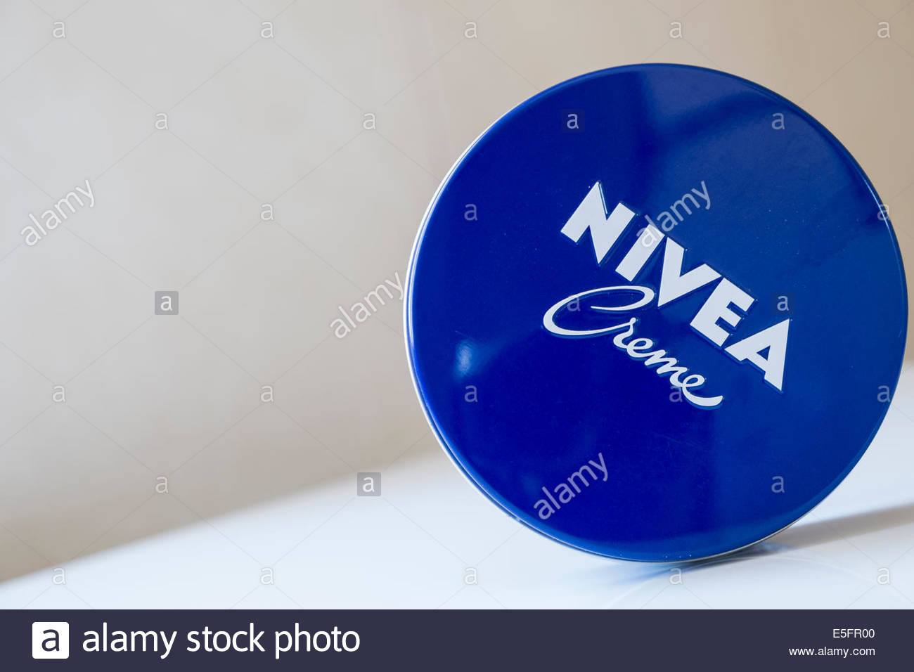 A distinctive blue tin of Nivea Creme - Stock Image