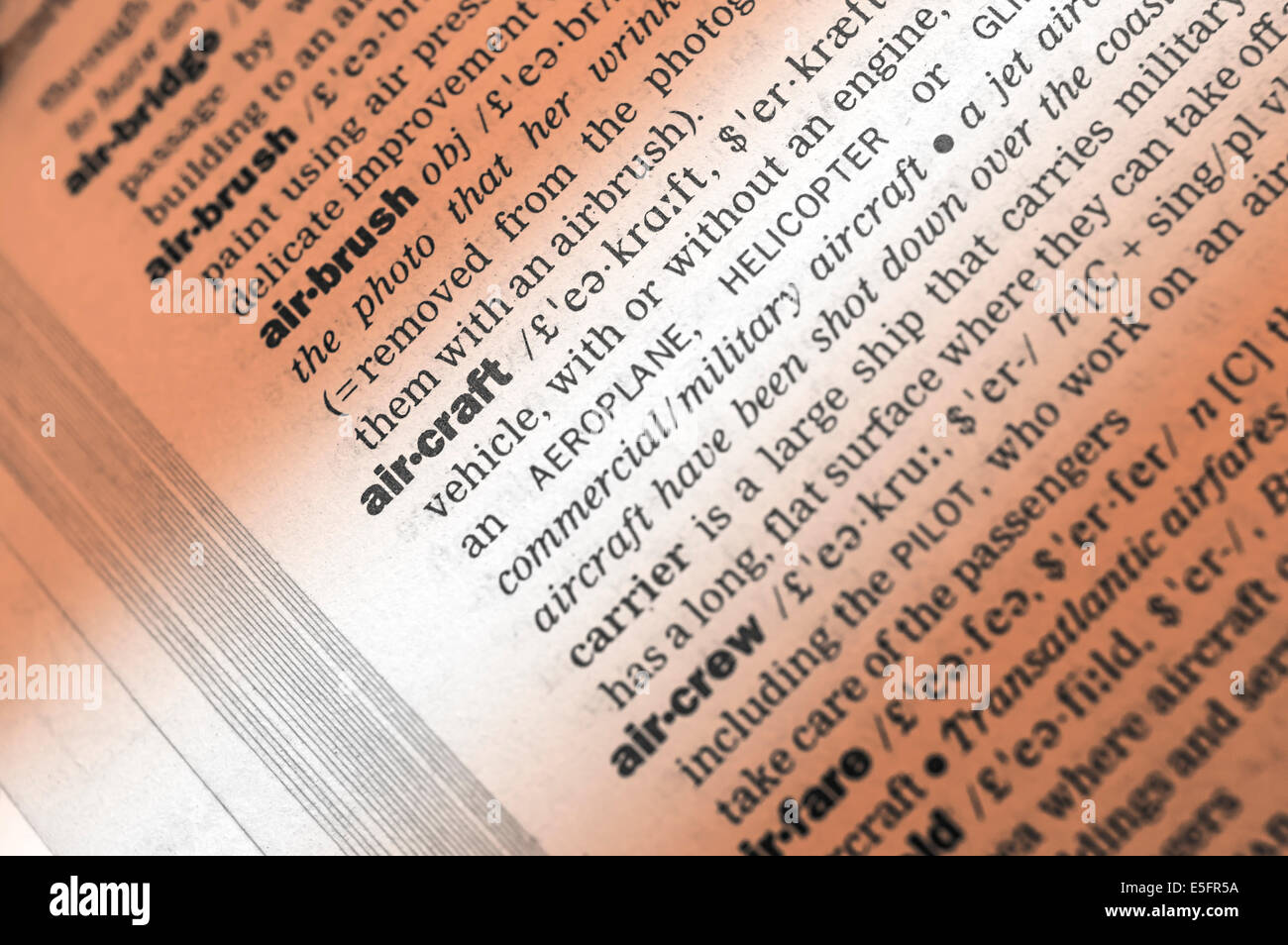 Dictionary words and phrases relating to air craft. Selective focus on air craft word - Stock Image