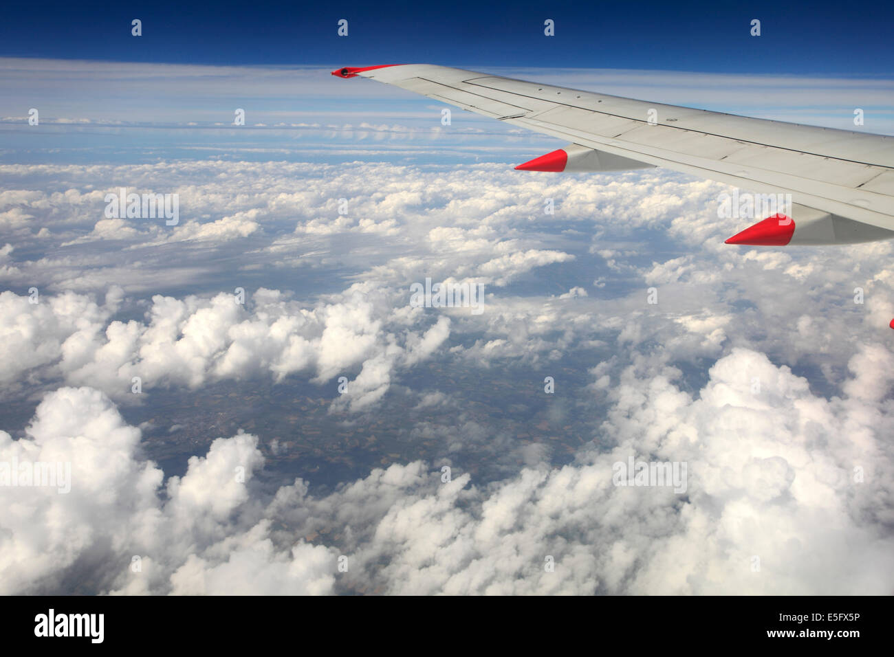 View from aeroplane window of Cumulus congestus clouds. - Stock Image