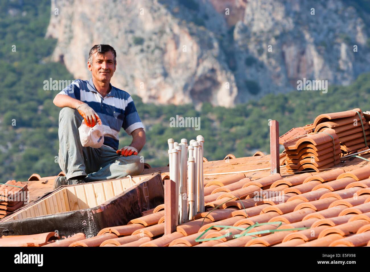 KAS, TURKEY Roofer at work. Stock Photo
