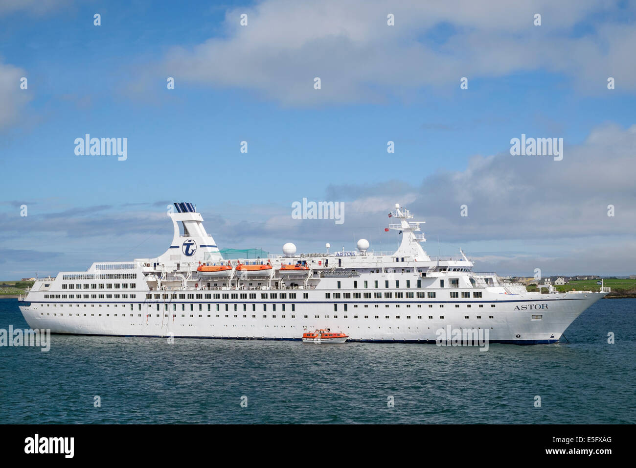 Large cruise liner ship MS Astor anchored at sea in Stornoway harbour, Isle of Lewis, Outer Hebrides, Western Isles, - Stock Image