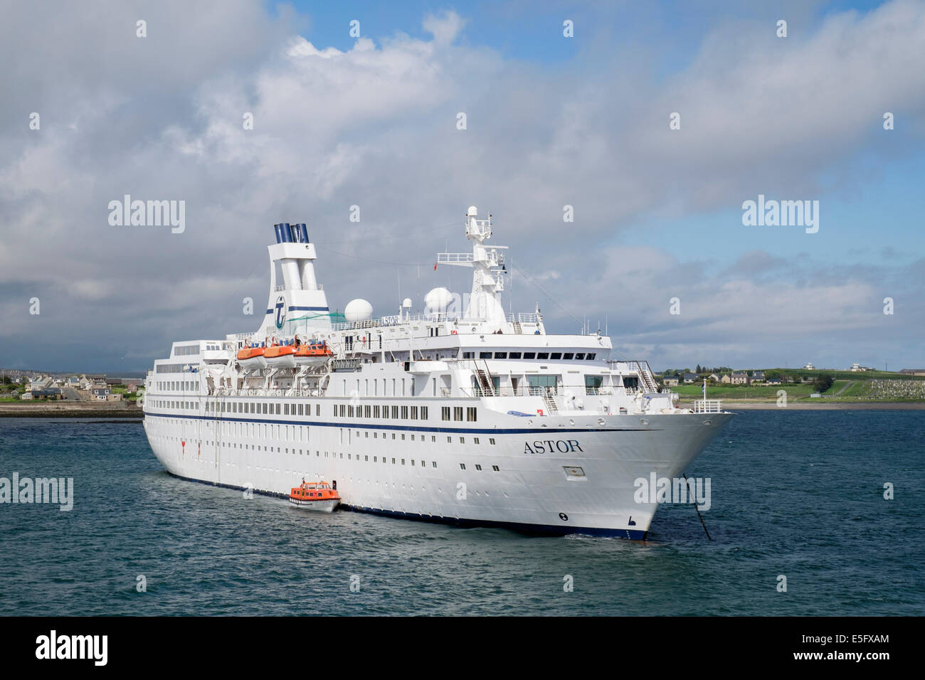 Large cruise liner MS Astor anchored at sea in Stornoway harbour, Isle of Lewis, Outer Hebrides, Western Isles, - Stock Image