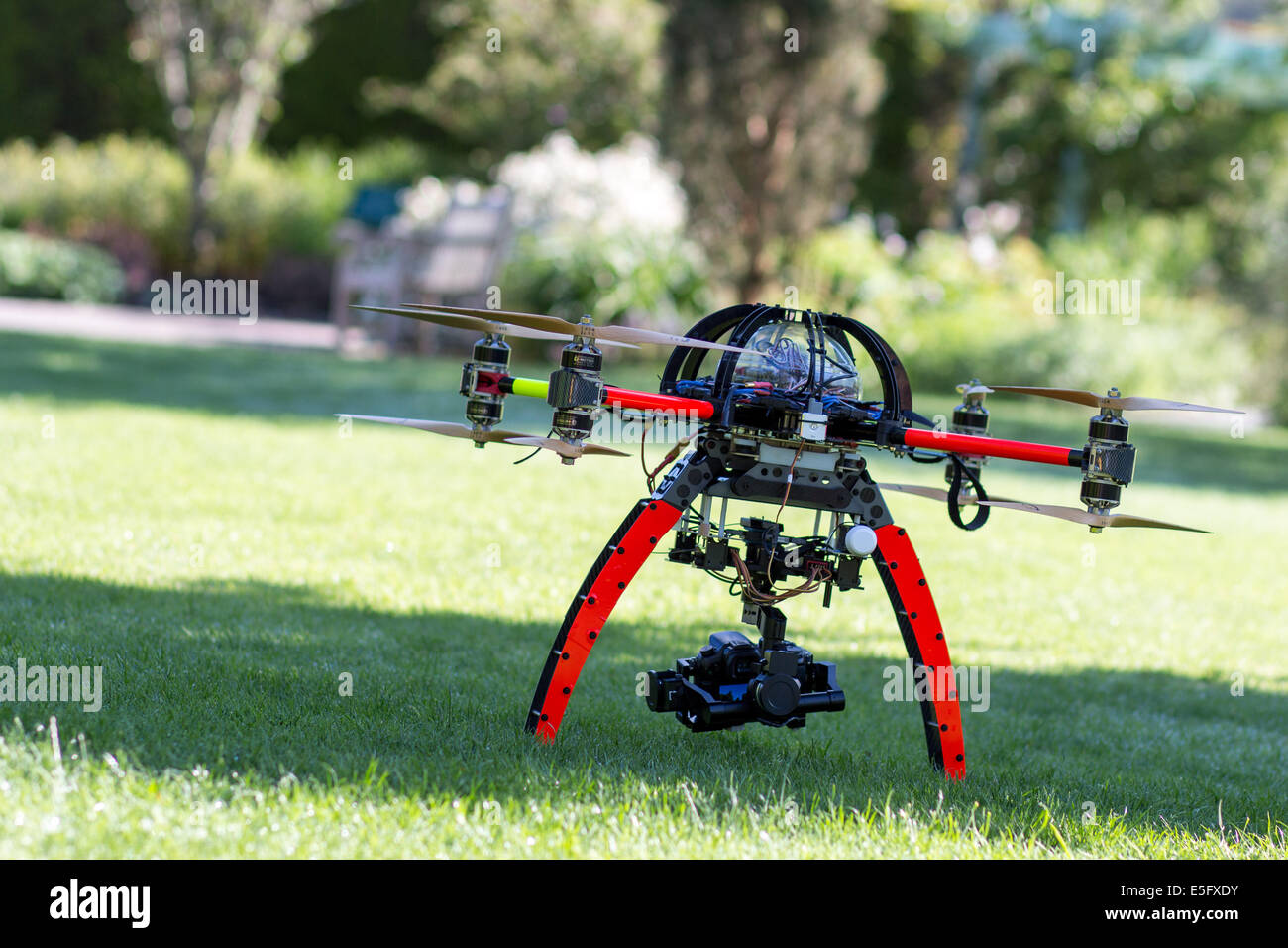 A drone or Unmanned Aircraft waiting for takeoff - Stock Image
