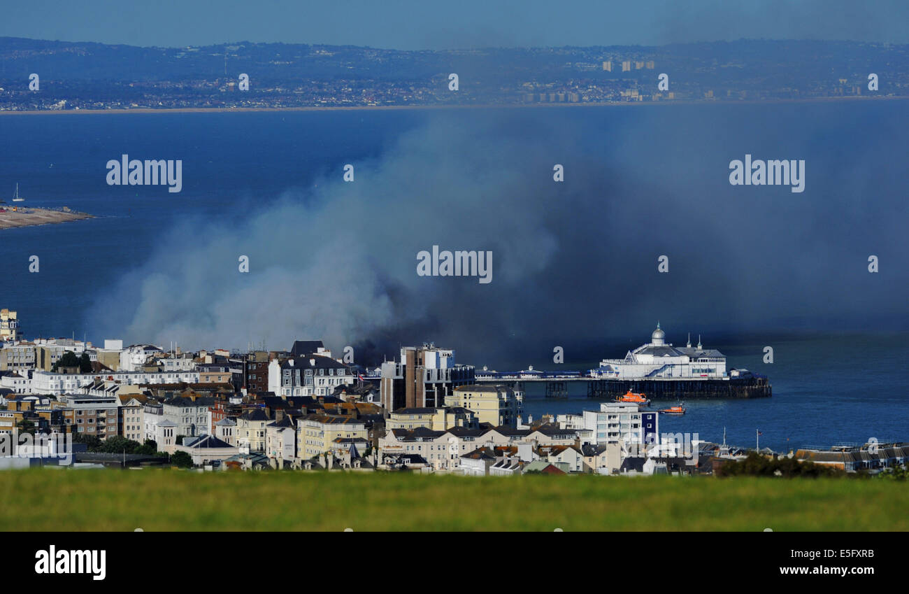Eastbourne, Sussex, UK. 30th July, 2014. Plumes of smoke rise above Eastbourne Pier fire after it  caught alight - Stock Image