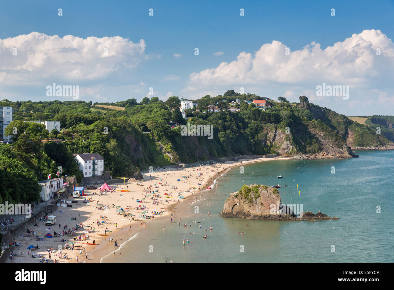 North beach in Tenby packed full of holidaymakers - pictured with Goscar Rock looking towards the north. Tourism - Stock Image