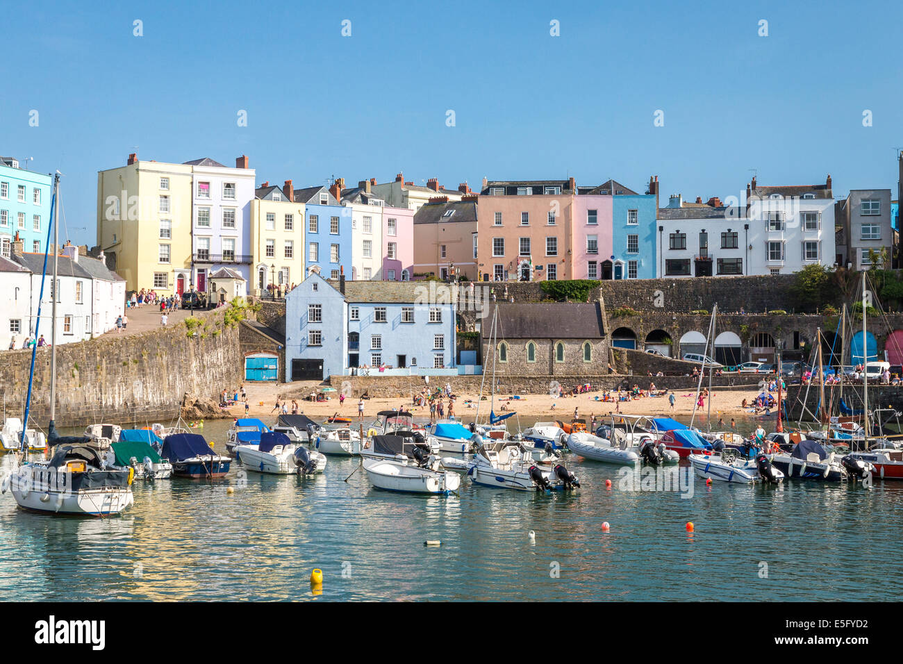 Tenby harbour full of boats on a sunny afternoon, the picturesque seaside town in Pembrokeshire, Wales - Stock Image