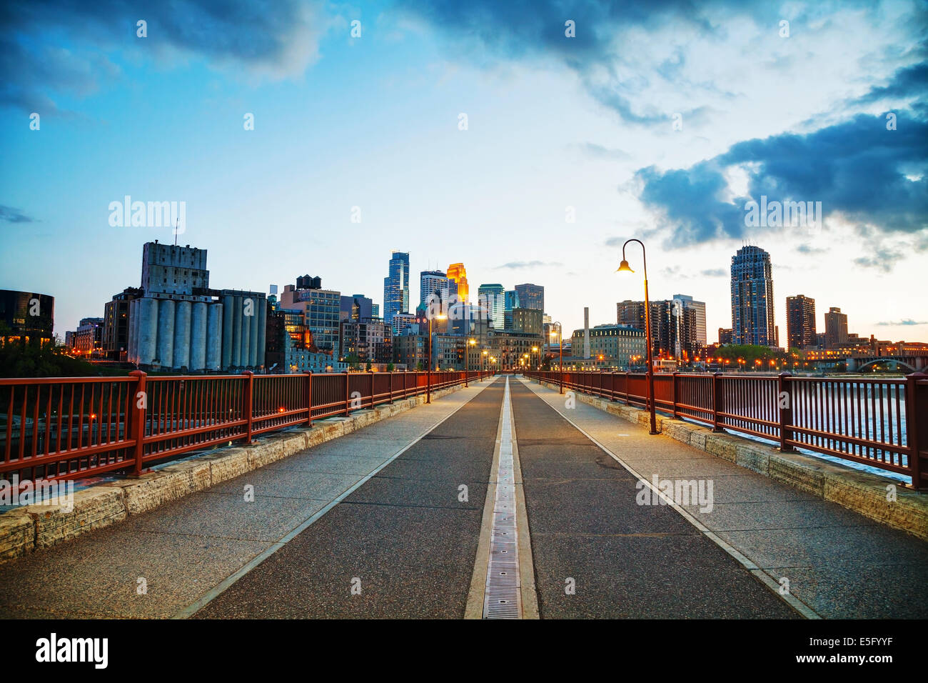 Downtown Minneapolis, Minnesota at night time as seen from the famous stone arch bridge - Stock Image