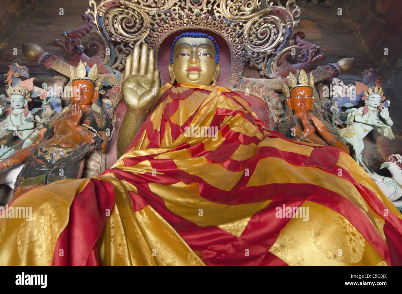 Sitting Buddha statue in the Gyantse Kumbum, a multi-storied aggregate of Buddhist chapels, in Tibet - Stock Image