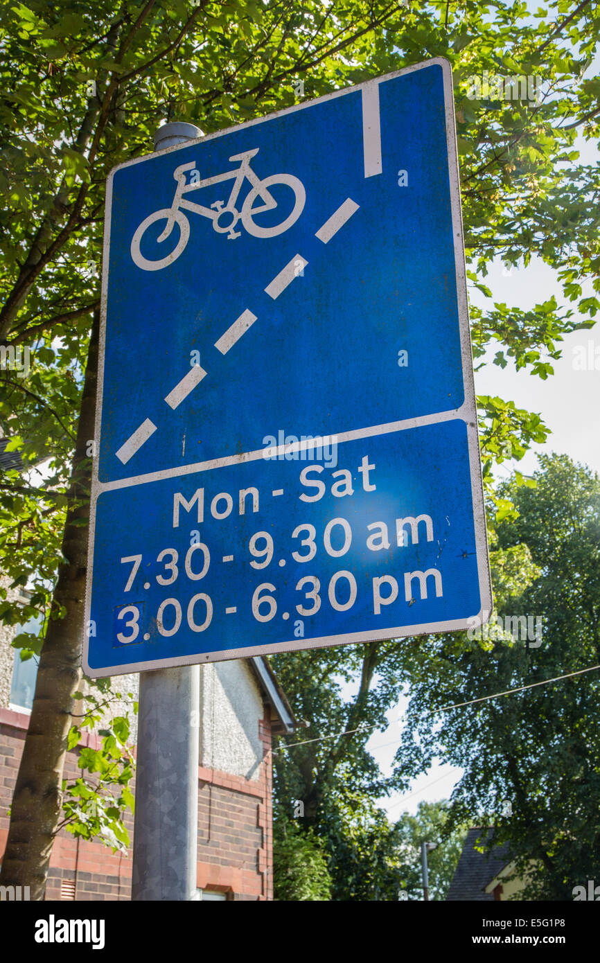 Bicycle cycle bike lane operating times sign signage - Stock Image
