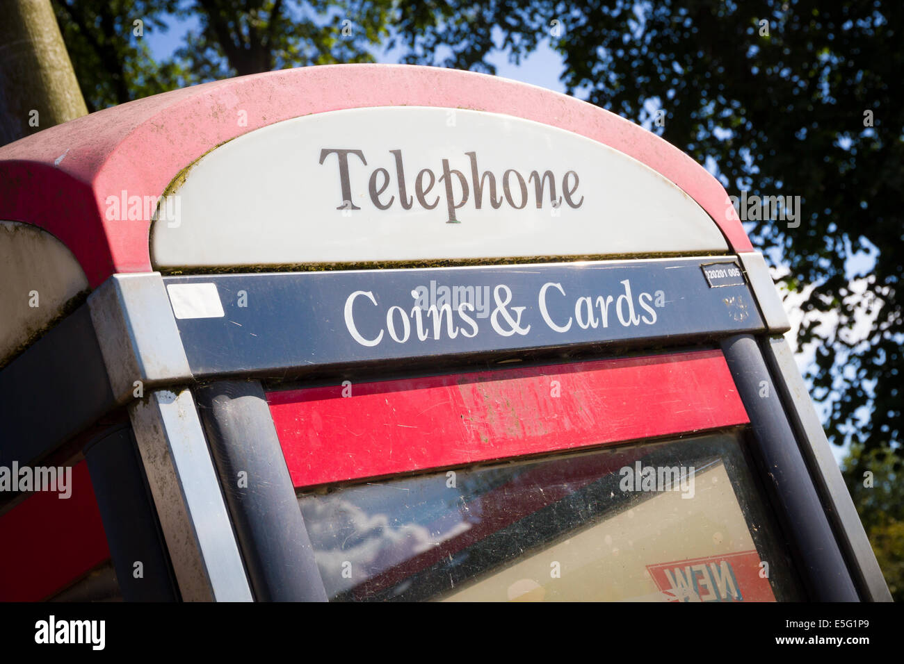 BT telephone box in England - Stock Image