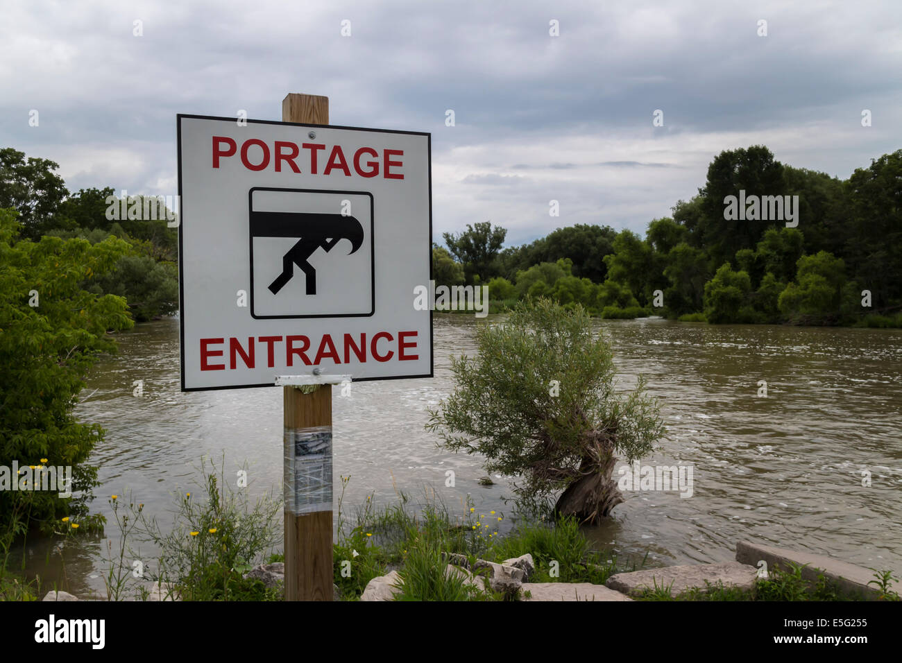 Sign identifying canoe access to river - Stock Image