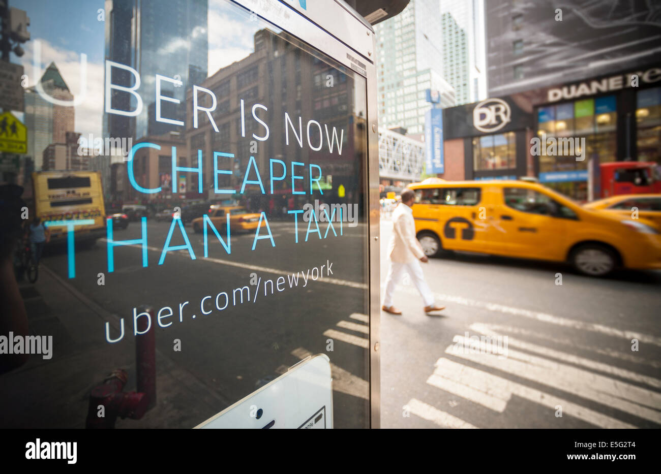 An advertisement on a telephone kiosk for Uber in Midtown in New York - Stock Image
