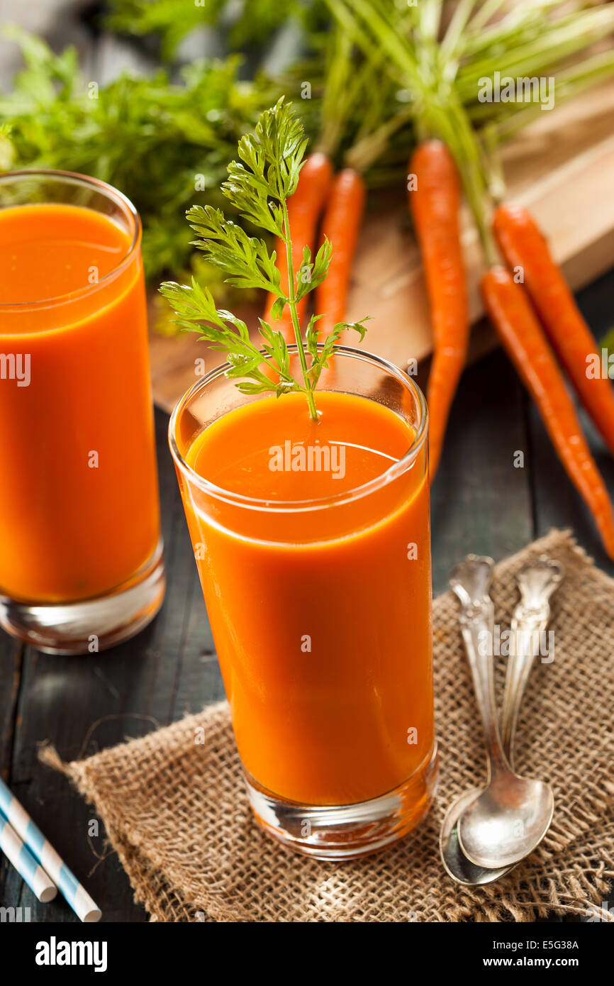 Organic Raw Carrot Juice with Fresh Fruit Stock Photo