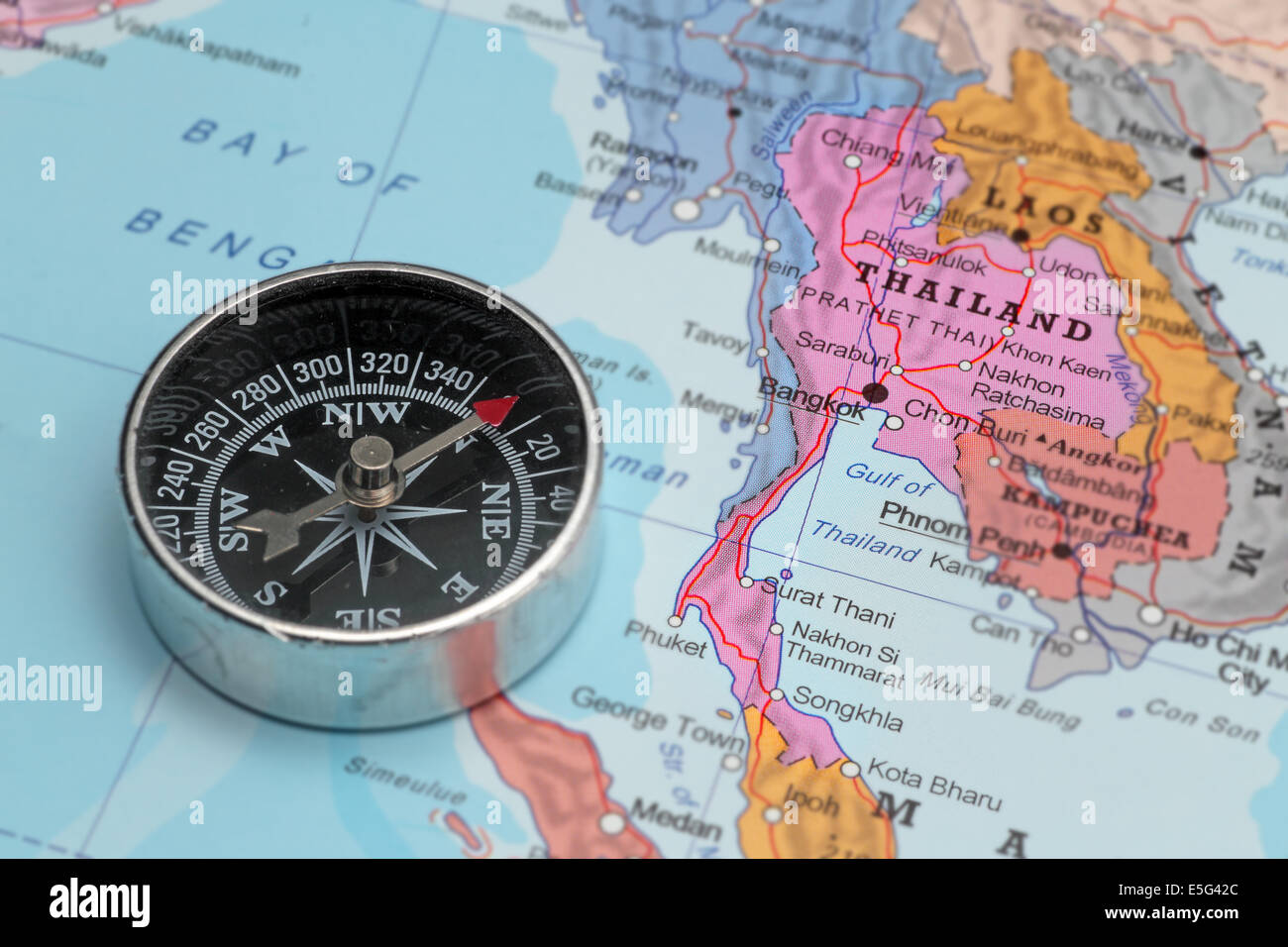 Compass on a map pointing at Thailand