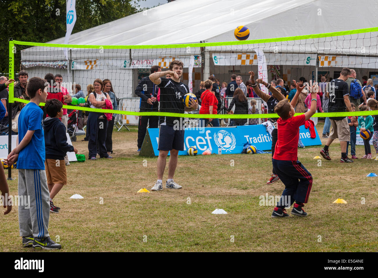 Glasgow, Scotland, UK. 30th July, 2014.  Boys trying out Volleyball on Glasgow Green during Festival 2014, a cultural - Stock Image