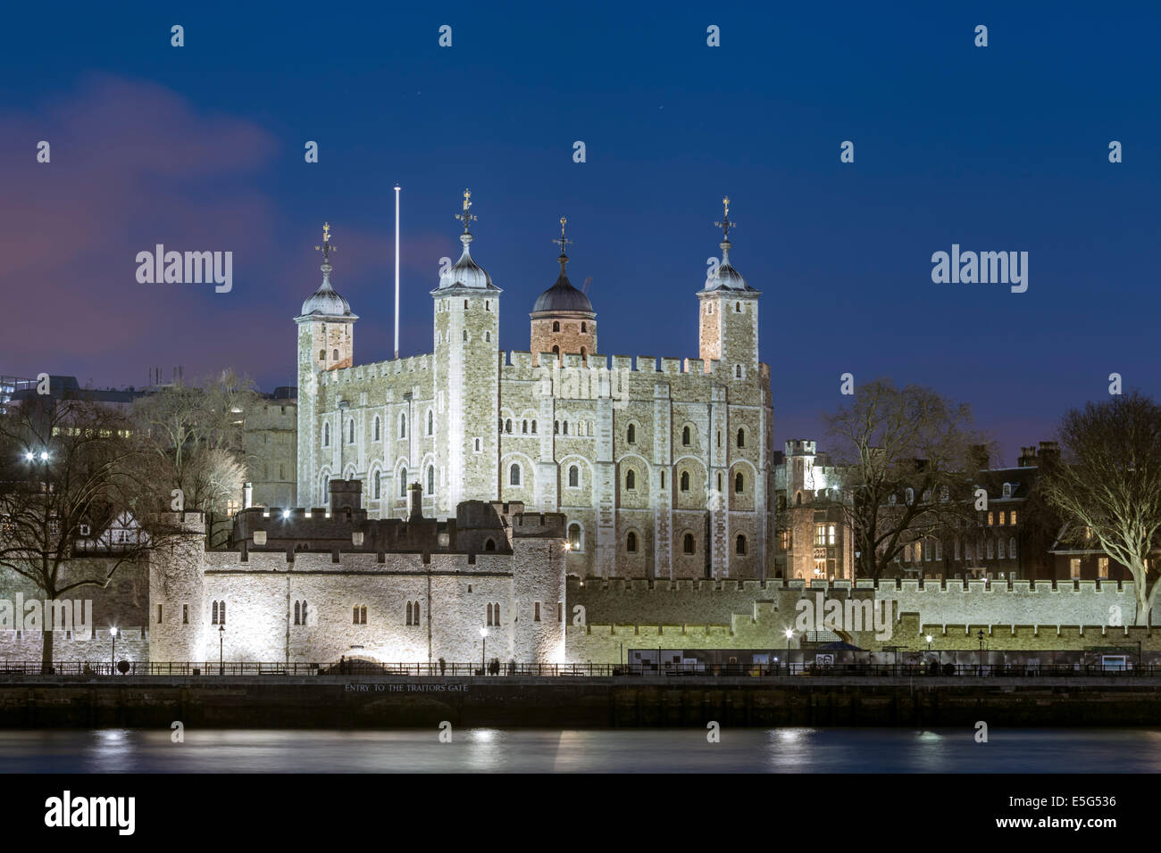 The Tower of London castle and royal palace, a UNESCO World Heritage Sight, illuminated at night, London, England - Stock Image