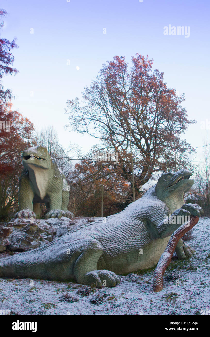 An Iguandon by 19th Century sculptor Benjamin Waterhouse Hawkins, Dinosaur Court, Crystal Palace park, in snow. Stock Photo