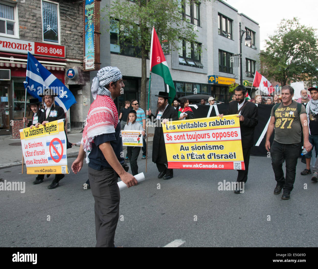 Montreal, Canada. 30th July, 2014. Montrealers took onto the streets to protest against the continious bombing of - Stock Image