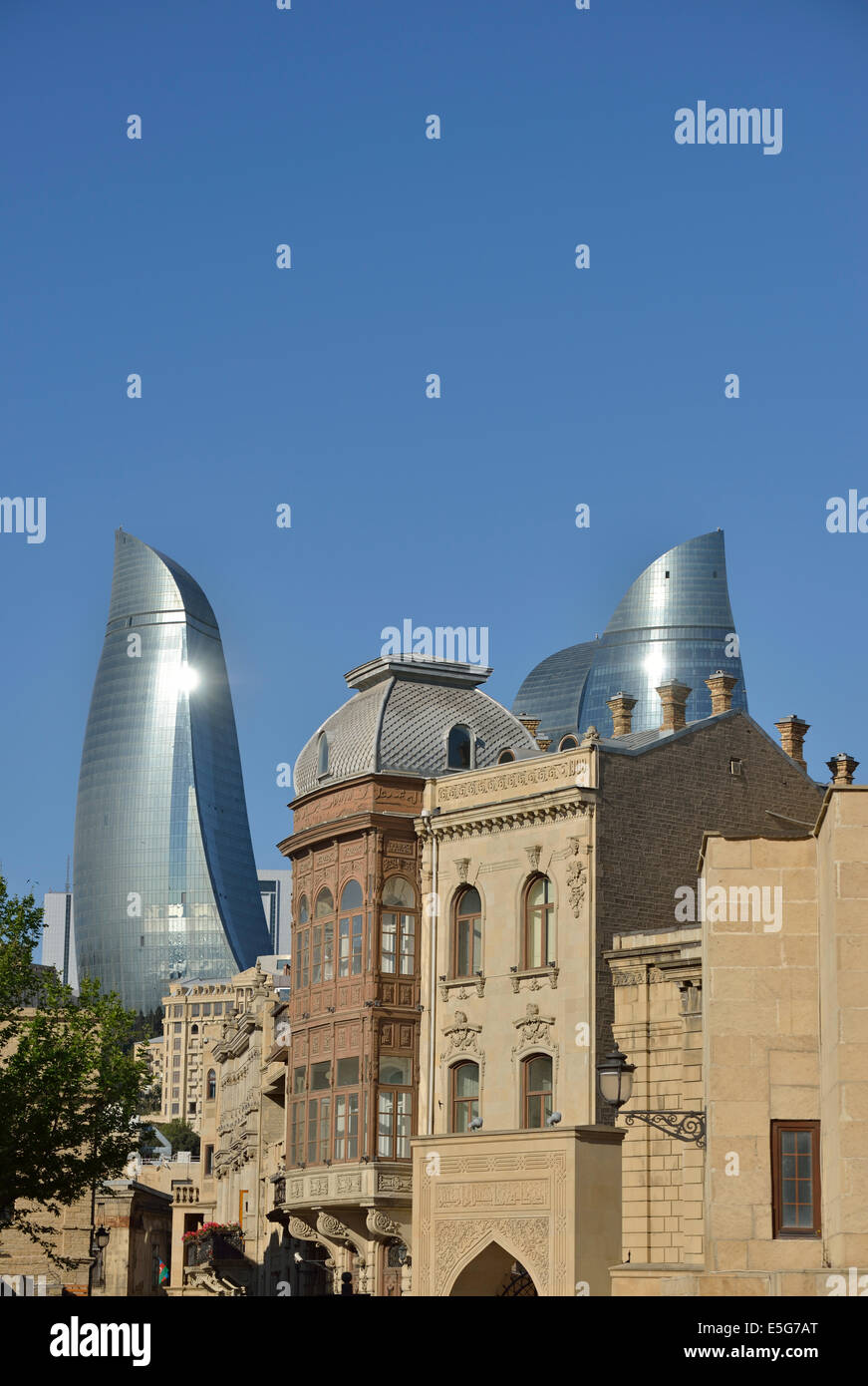 Flame Towers visible over the buildings of the Old City, Baku, Azerbaijan - Stock Image