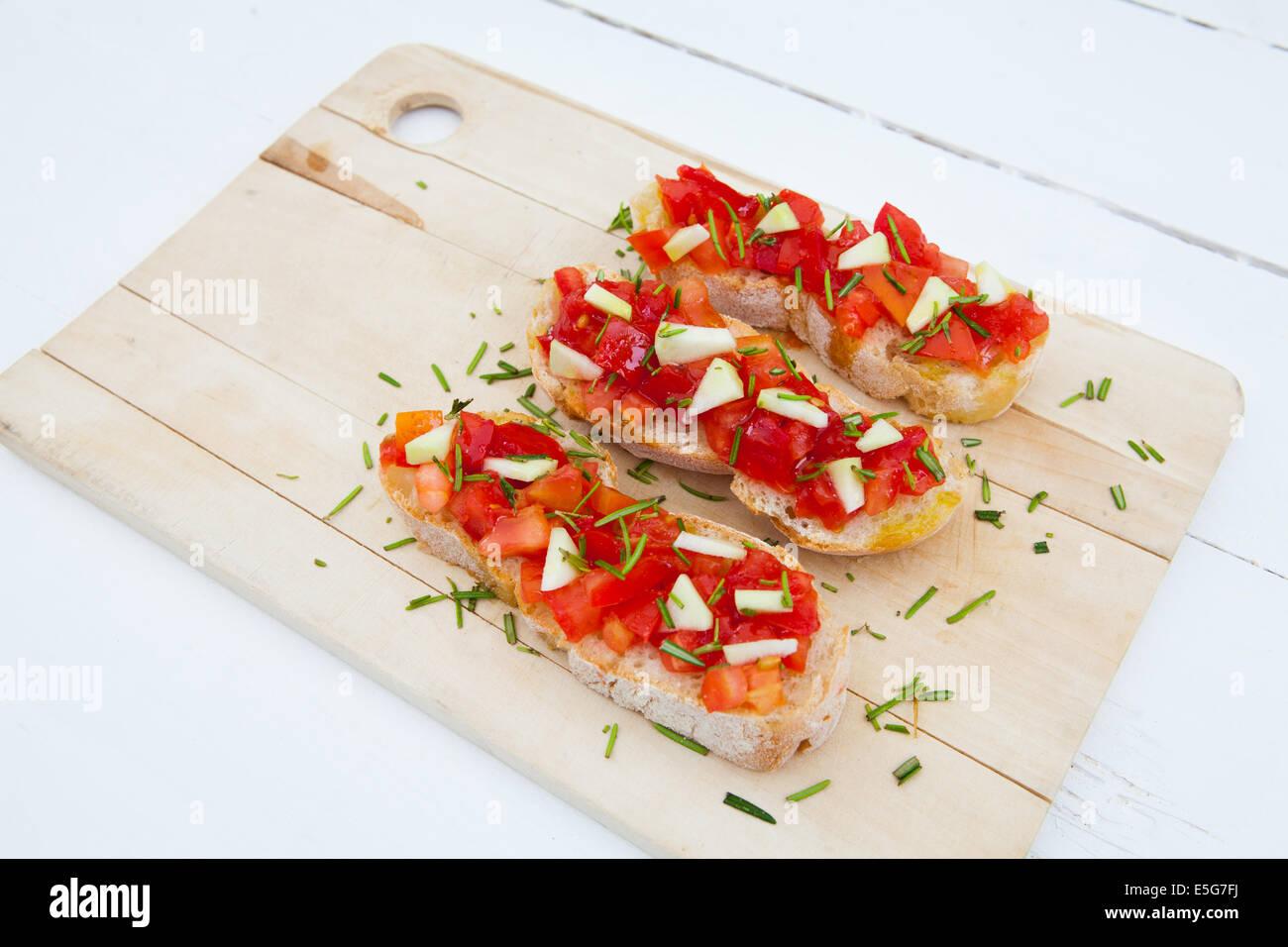 Ready to eat italian bruschetta with tomatoes and rosemary Stock Photo