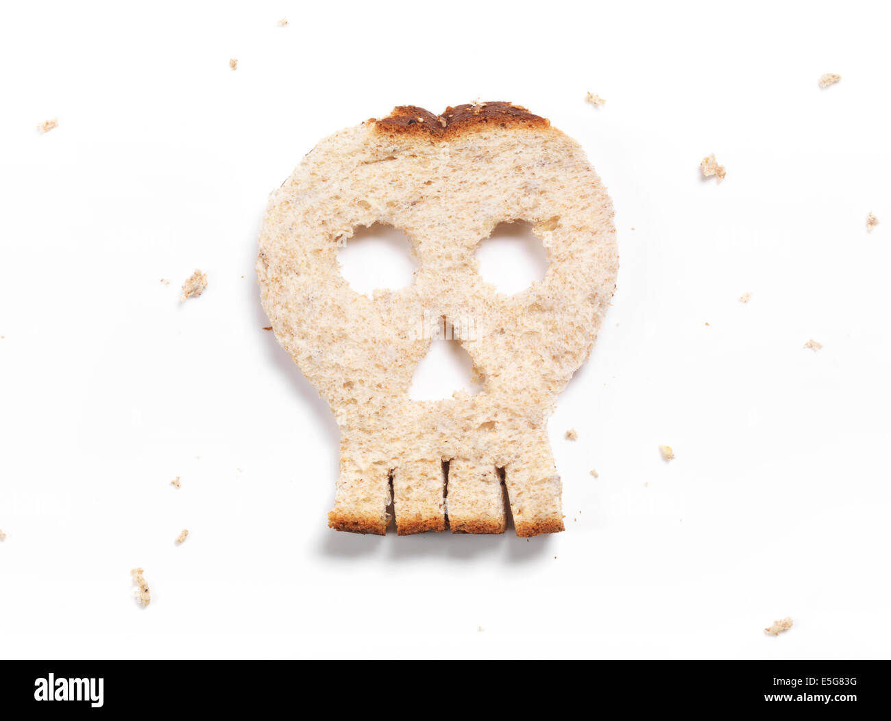 Skull made of bread isolated on white background - Stock Image