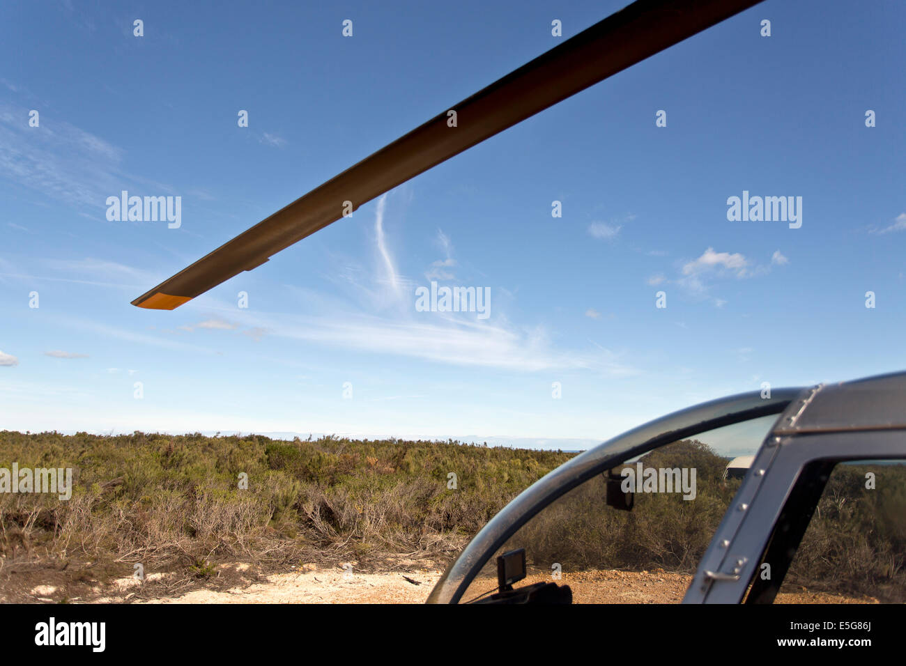 View of a helicopter blade and part of the cabin - Stock Image