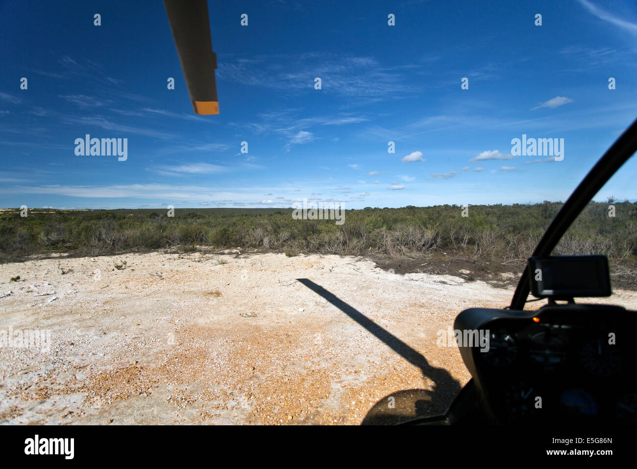 Helicopter blade seen from inside the cockpit - Stock Image