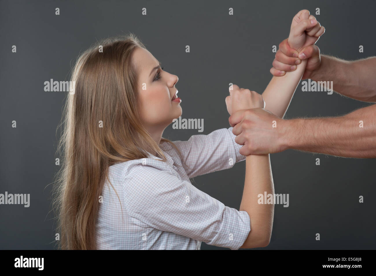 Violence of man against woman - Stock Image