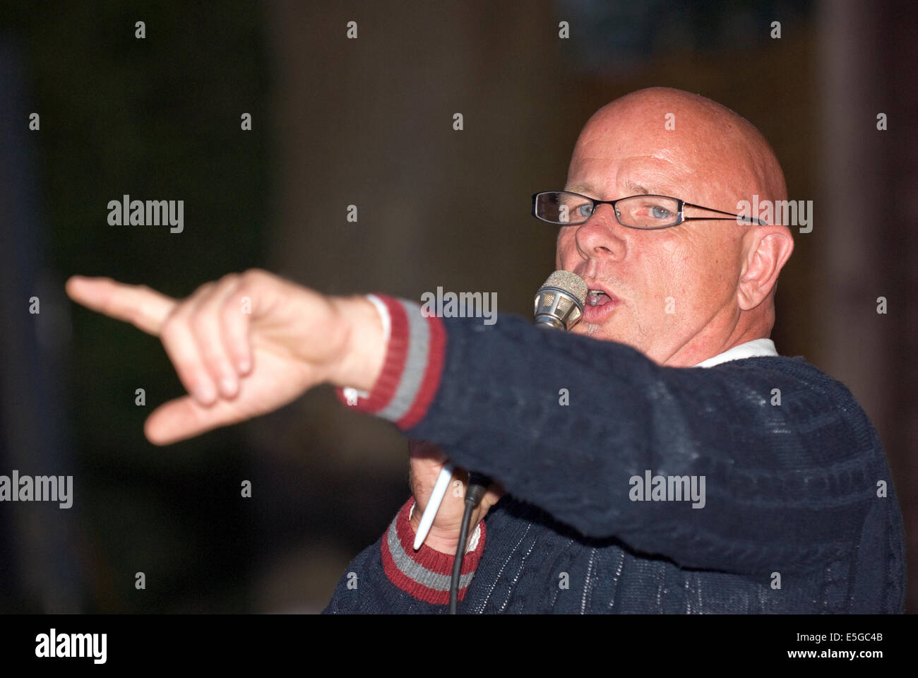 Auctioneer at work taking bids for goods at a fundraising event for local charities, Churt, near Farnham, Surrey, Stock Photo
