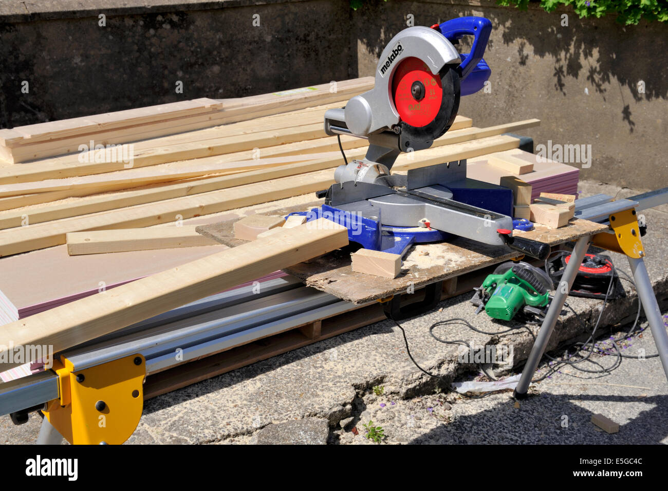 Sliding compound mitre chop saw on portable saw table for construction work Stock Photo
