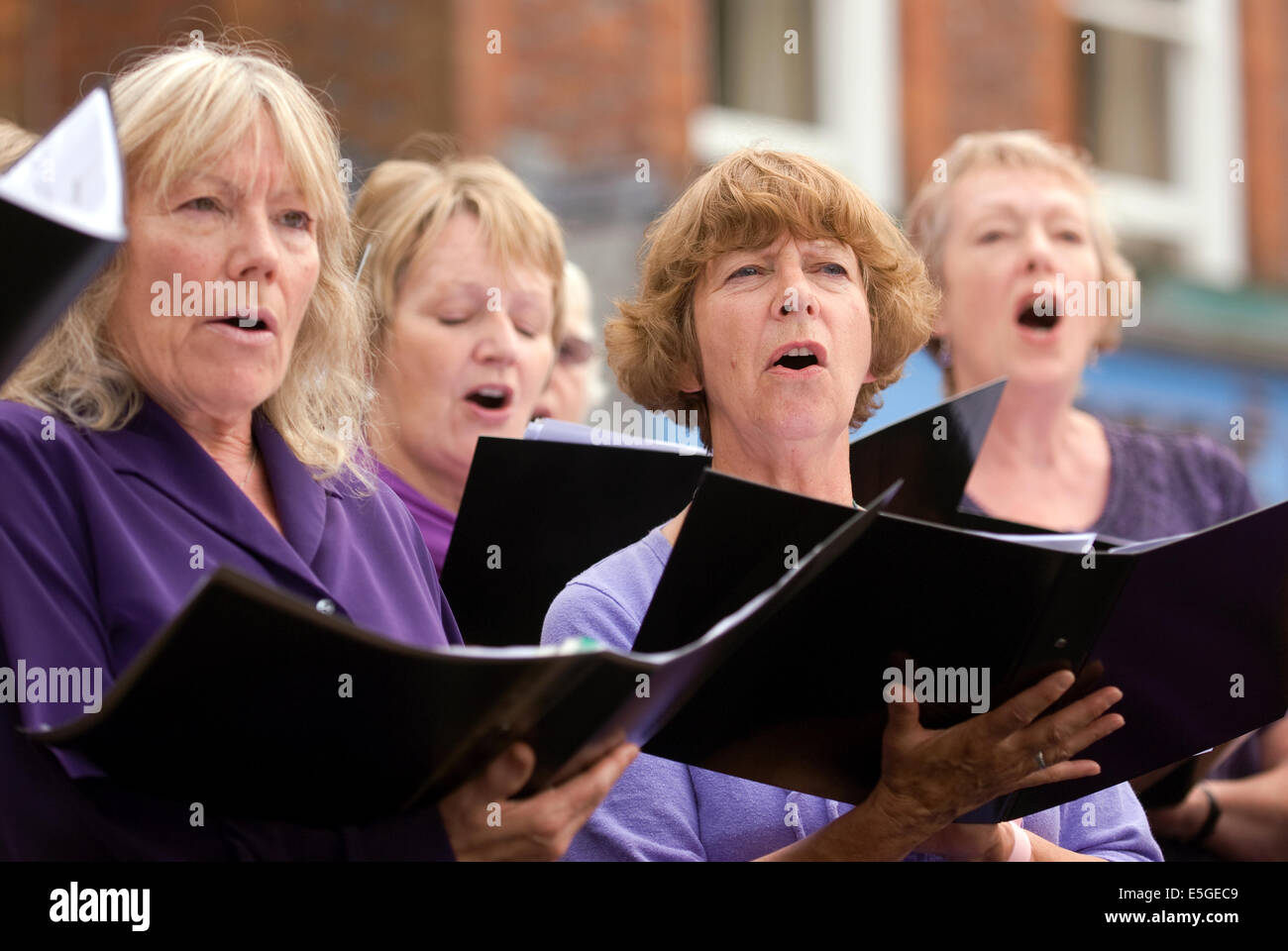 Local community choir group performing as part of the celebrations of the centenary of the World War One conflict, - Stock Image
