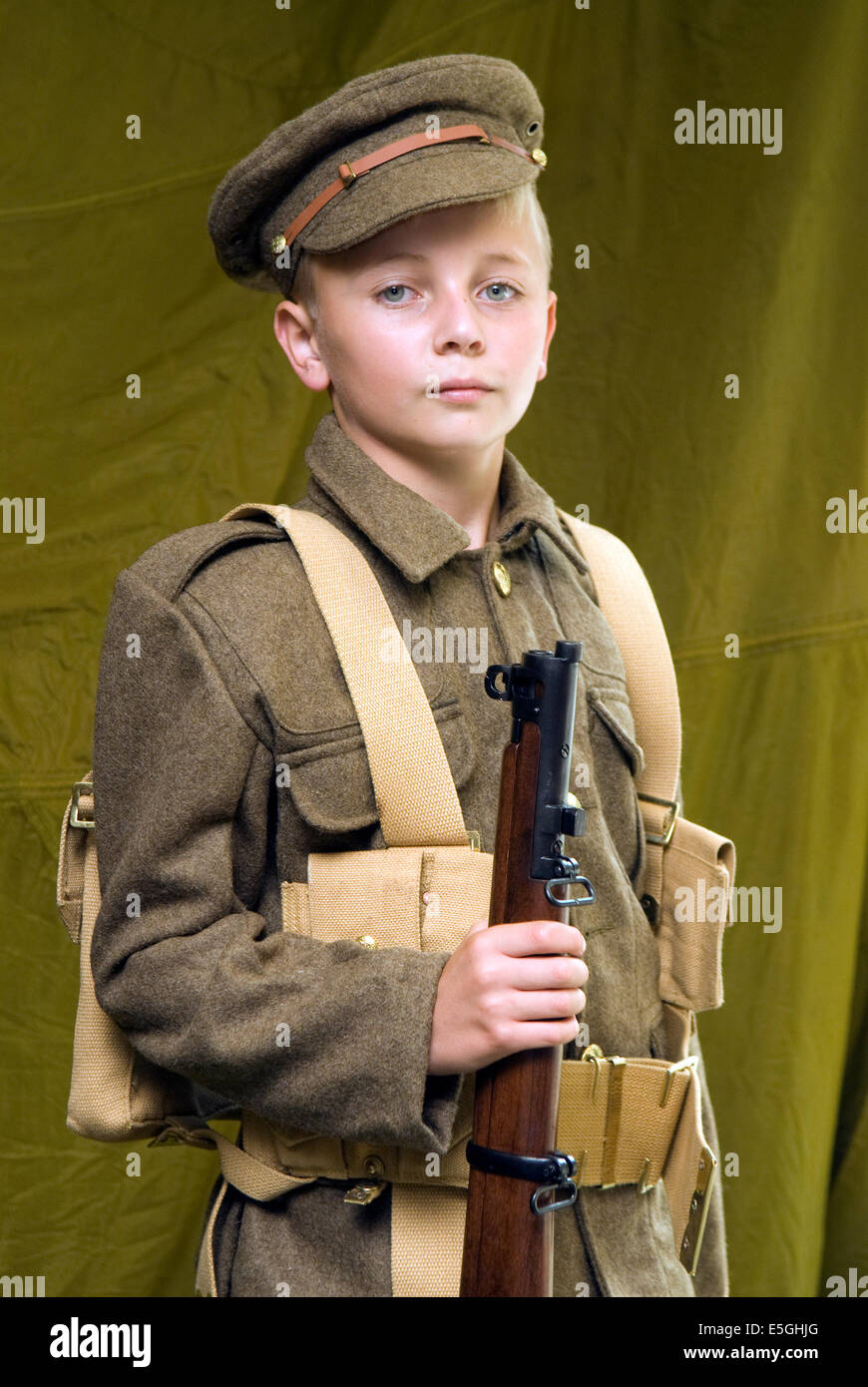 10 year old boy at a World War One history event dressed in WW1 uniform, near Haslemere, Surrey, UK. - Stock Image