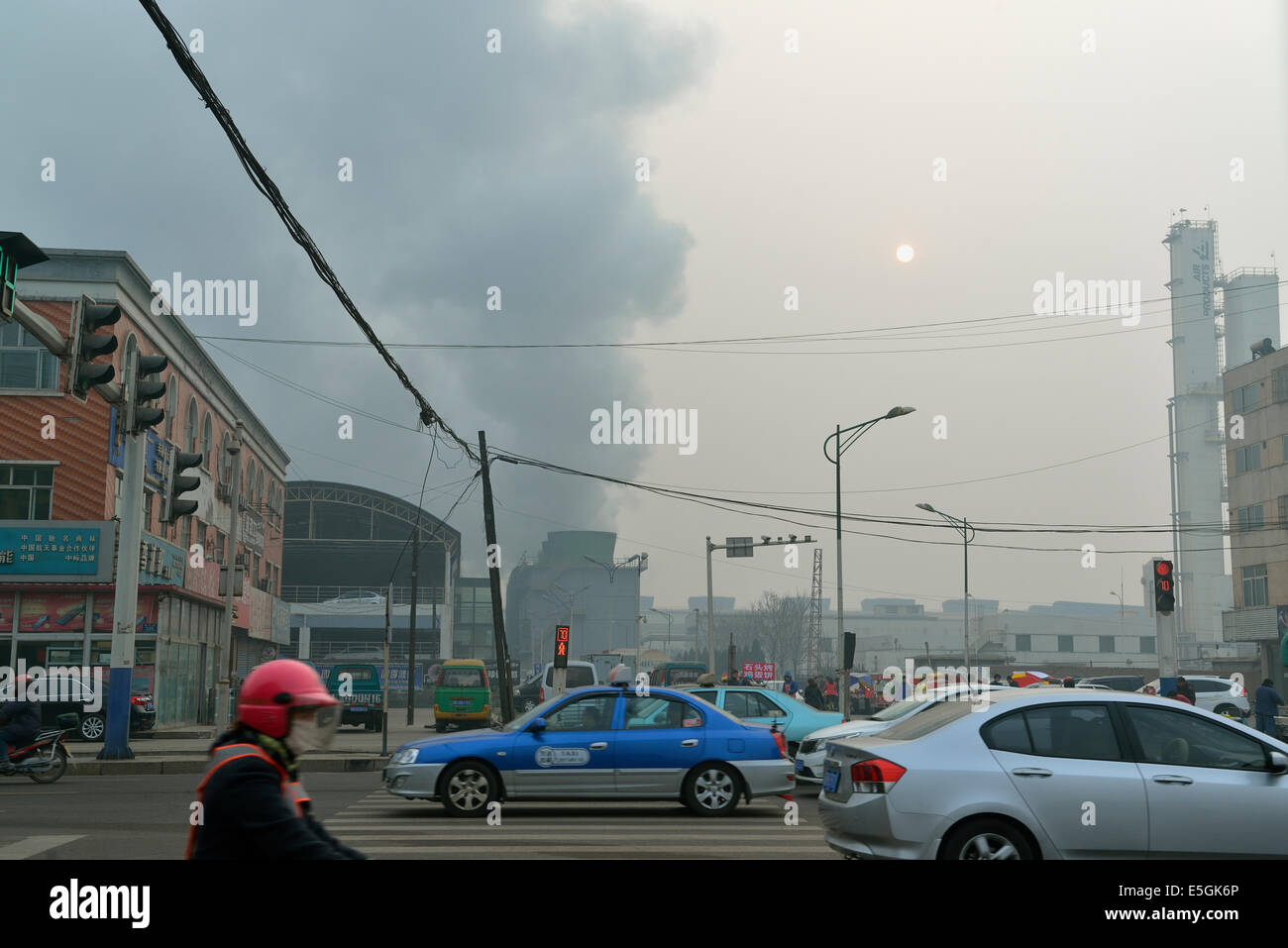 Black smoke covers a private iron and steel factory in Tangshan, Hebei province, China. 26-Mar-2014 - Stock Image