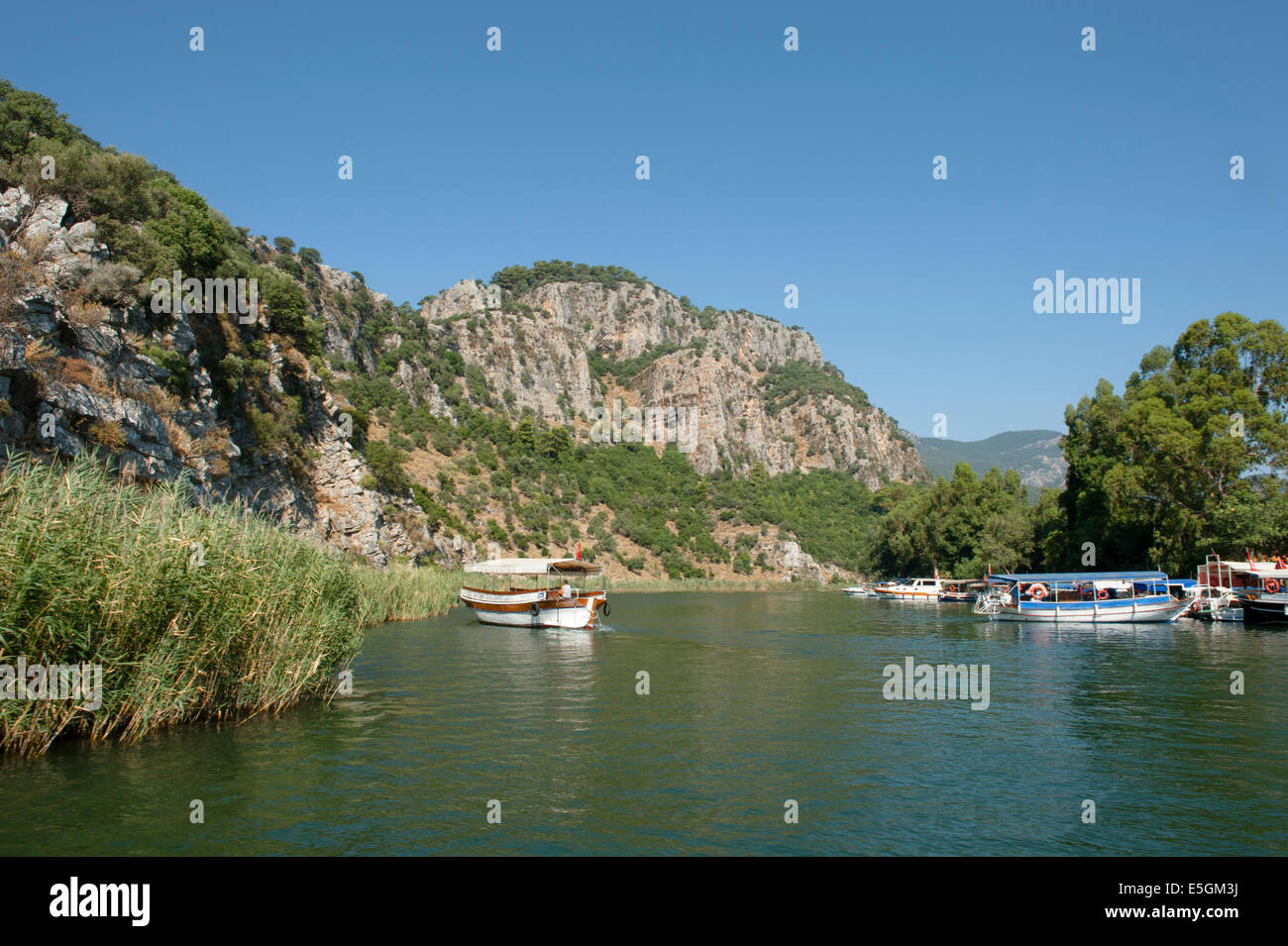 Boating is a popular pastime on the Dalyan river in Mugla province, Turkey - Stock Image