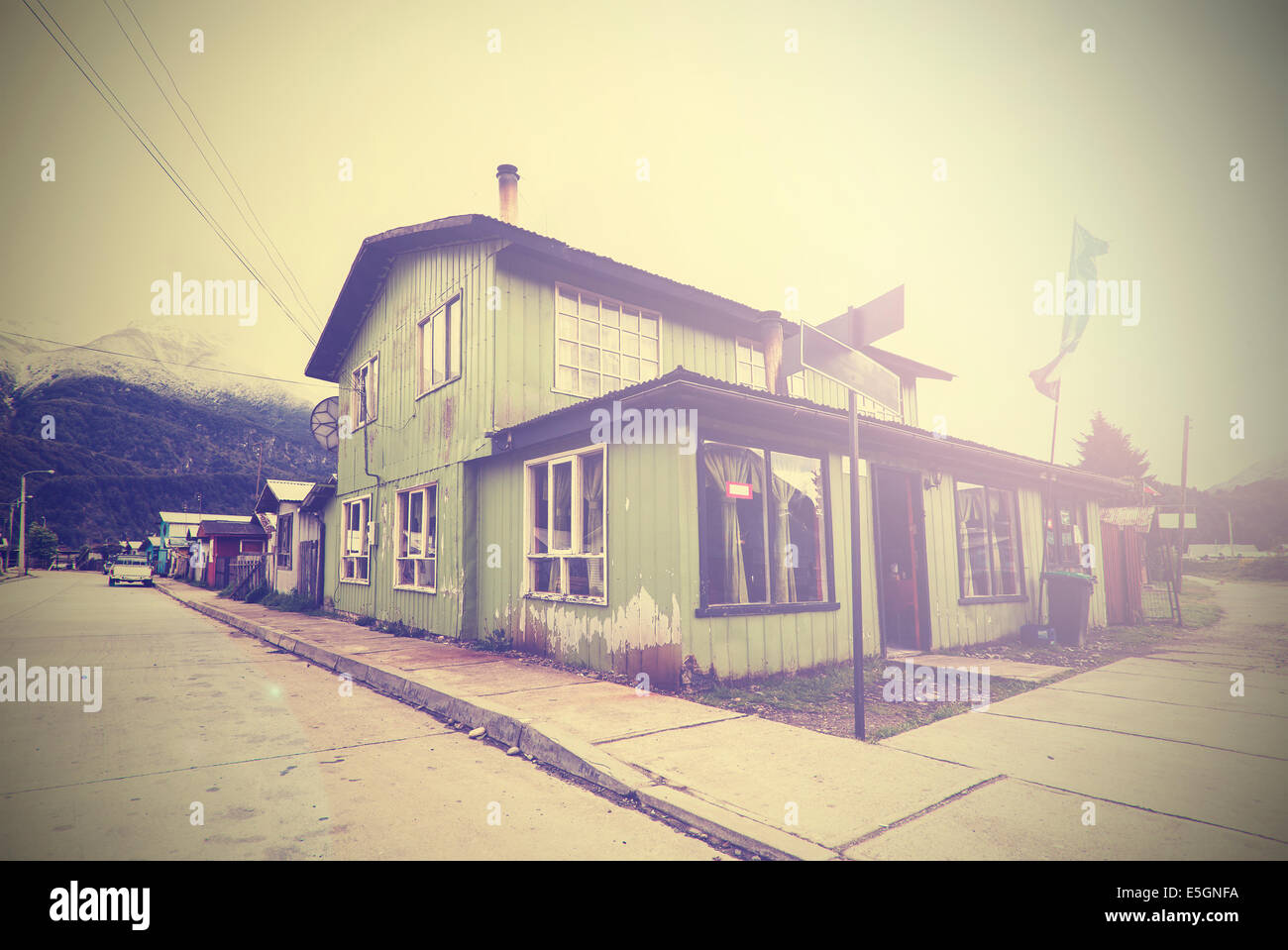 Vintage picture of mountain village street. - Stock Image