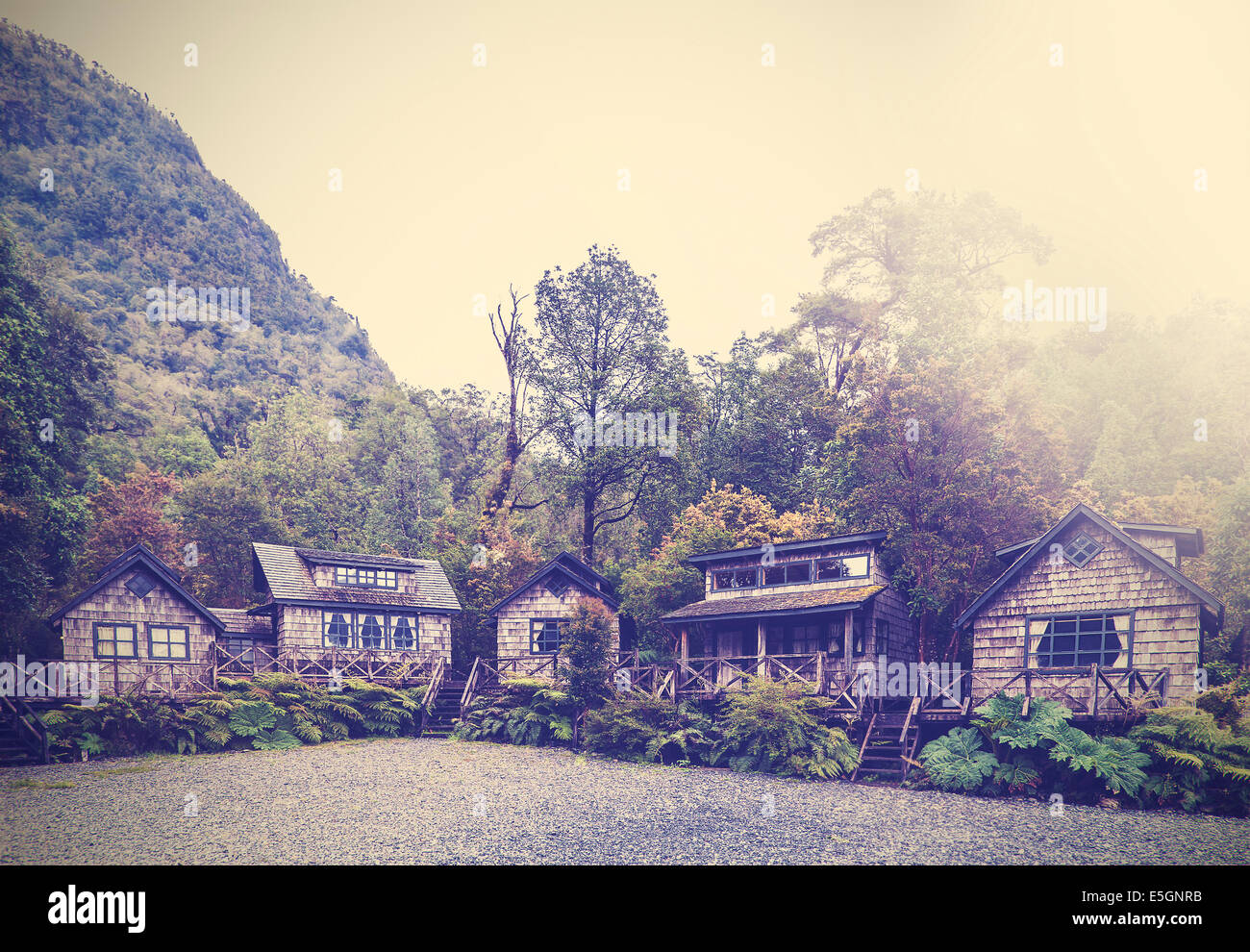 Vintage picture of village huts. - Stock Image