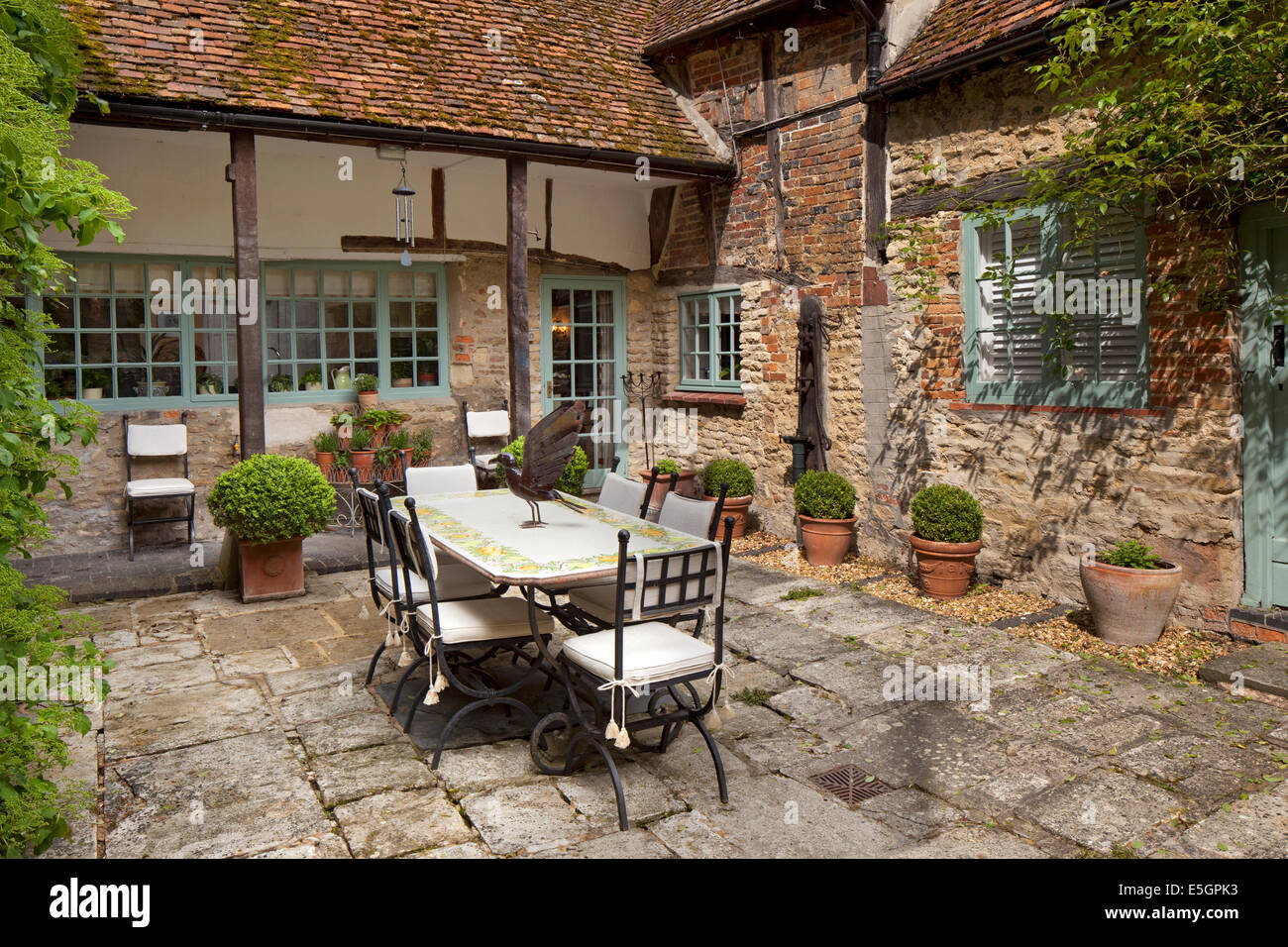 outdoor garden terrace eating area in courtyard of house,England - Stock Image