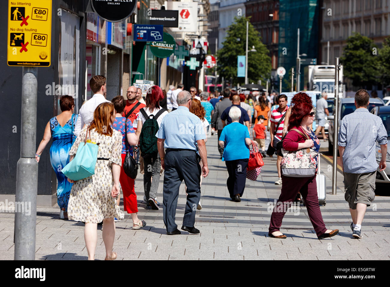 busy donegall place shopping street on a summers day Belfast city centre - Stock Image