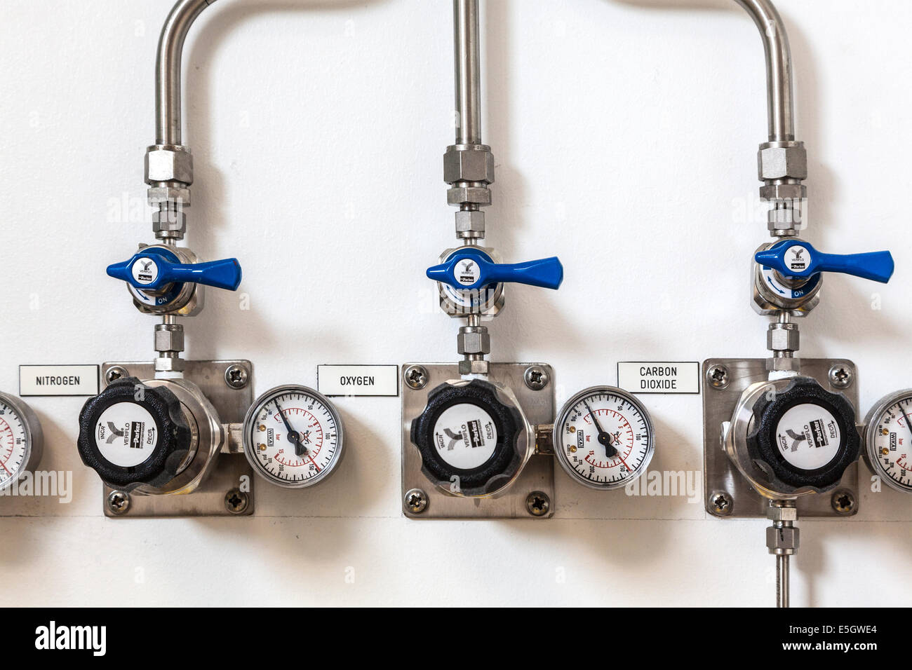 Pipes supplying a scientific research laboratory with the main gases found in our atmosphere. - Stock Image