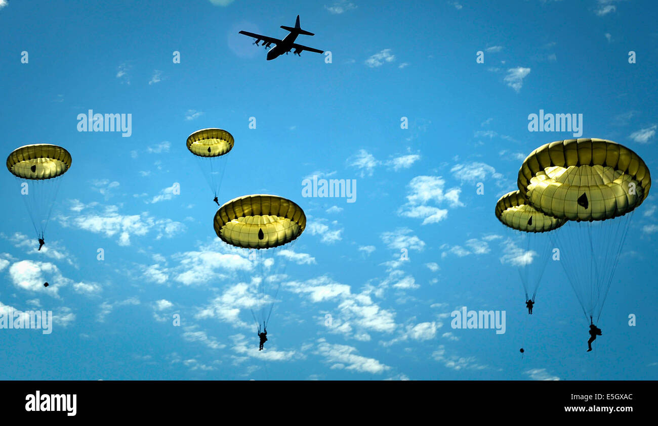 Paratroopers jump onto the Iron Mike drop zone in Sainte-M?re-?glise, France, June 8, 2014. More than 600 U.S., Stock Photo