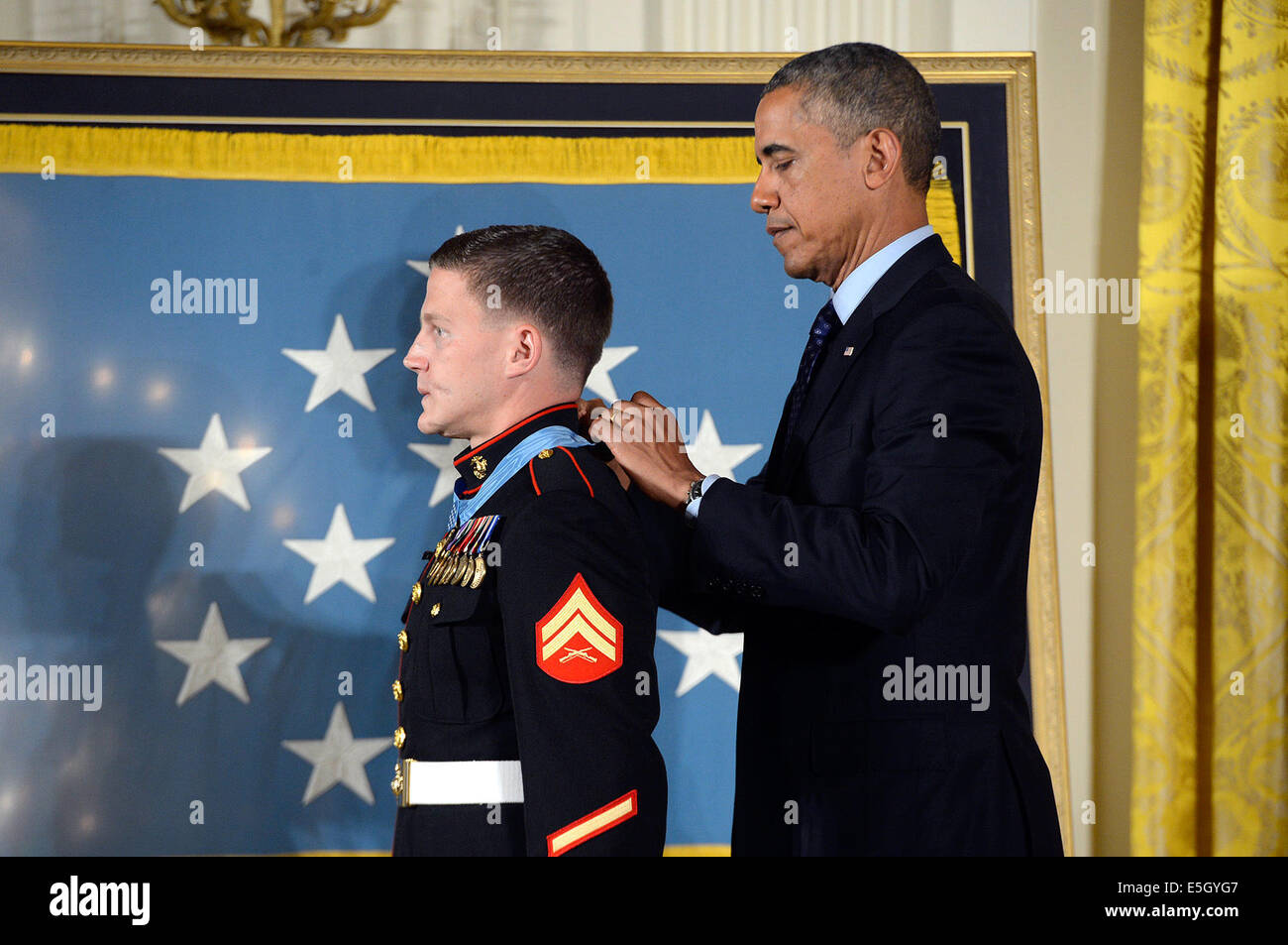 President Barack Obama, right, awards the Medal of Honor to retired U.S. Marine Corps Cpl. William Carpenter during Stock Photo