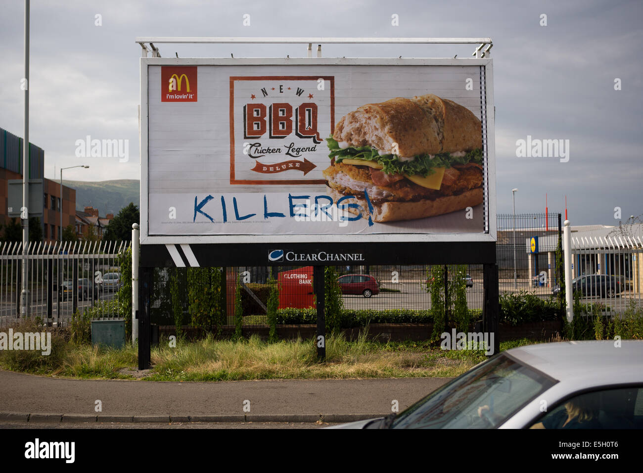 Andersonstown Rd, West Belfast, Ireland. 31st July, 2014. The word 'Killers' has been written on a McDonalds - Stock Image