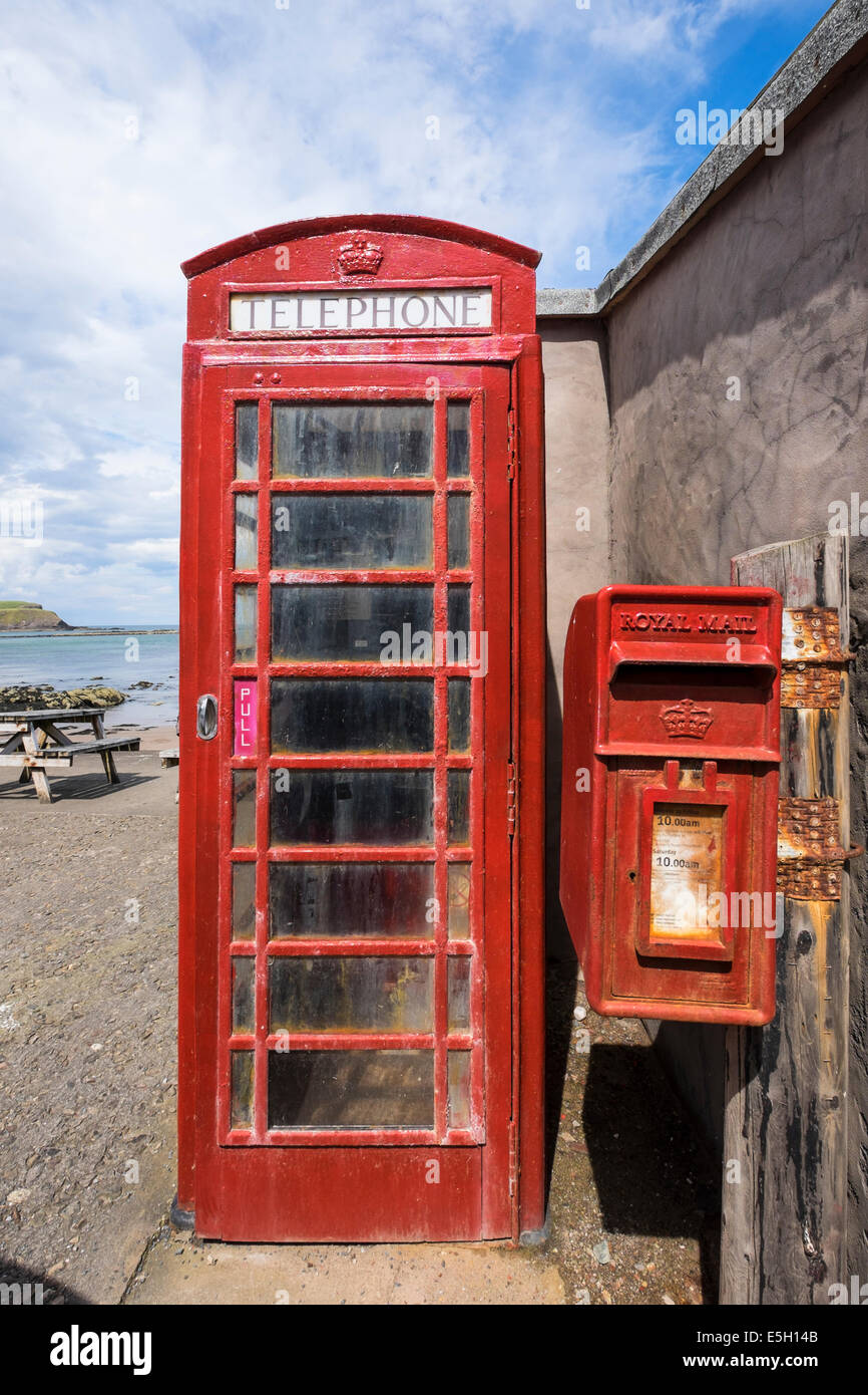 `red telephone box in Pennan village on coast in Aberdeenshire Scotland - Stock Image
