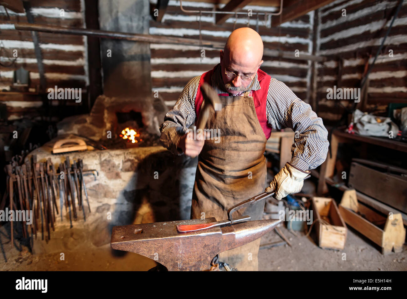 Blacksmith hammering on anvil, Festival du Voyageur, Winnipeg, Manitoba, Canada - Stock Image