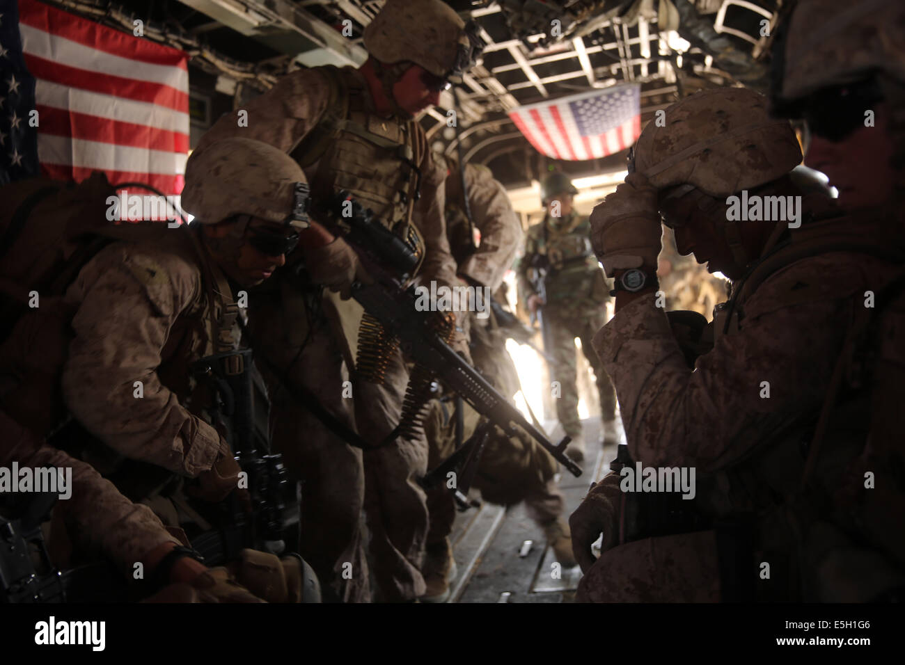 U.S. Marines with Bravo Company, 1st Battalion, 7th Marine Regiment board a CH-53E Super Stallion helicopter during Stock Photo