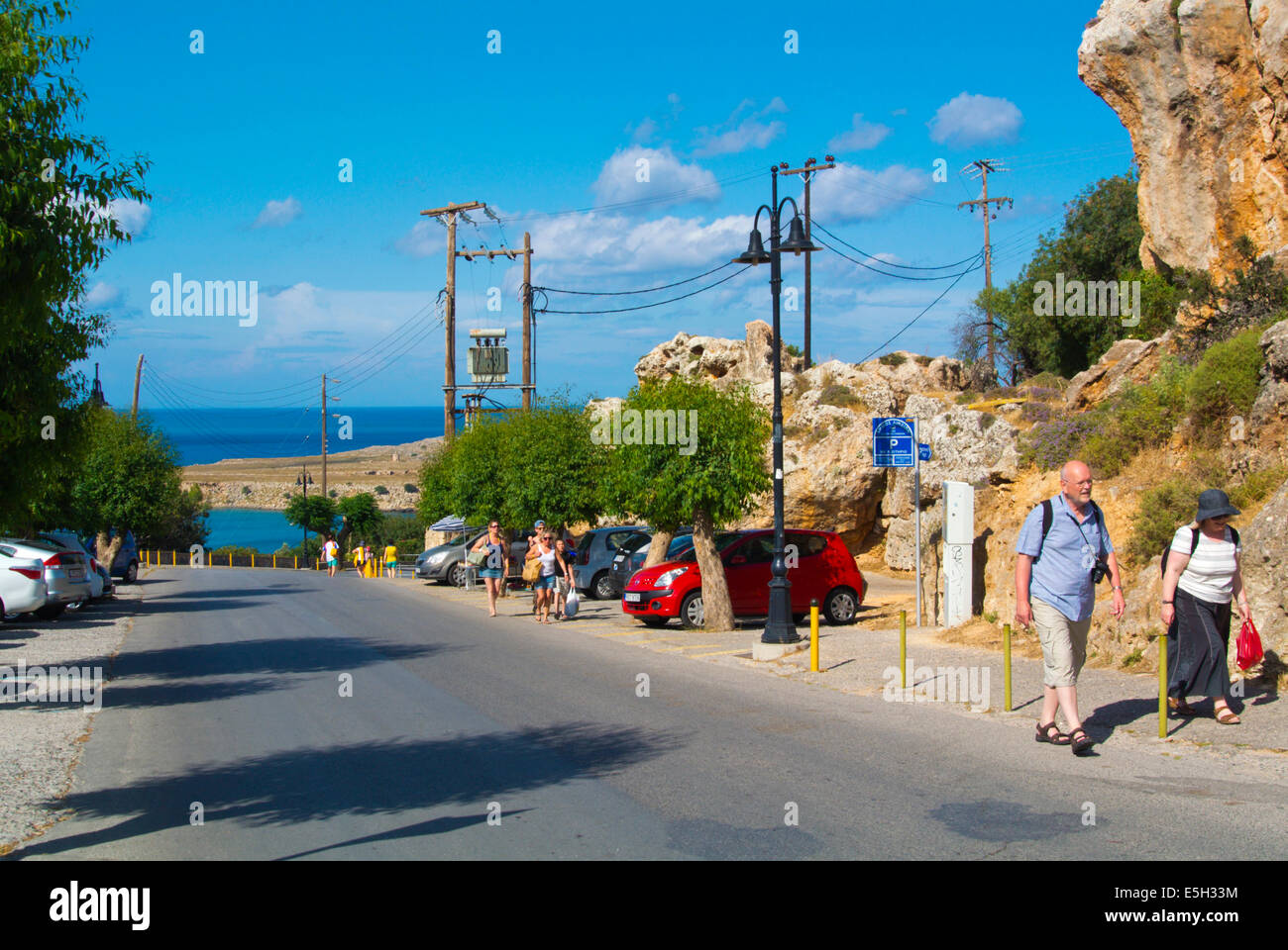 Road leading down to the old town and beach, Lindos town, Rhodes island, Dodecanese islands, Greece, Europe - Stock Image