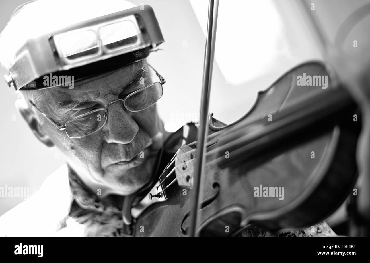 Howard Needham, violinist and violin craftsman, at his home workshop located in Silver Spring, Maryland, June 20, - Stock Image