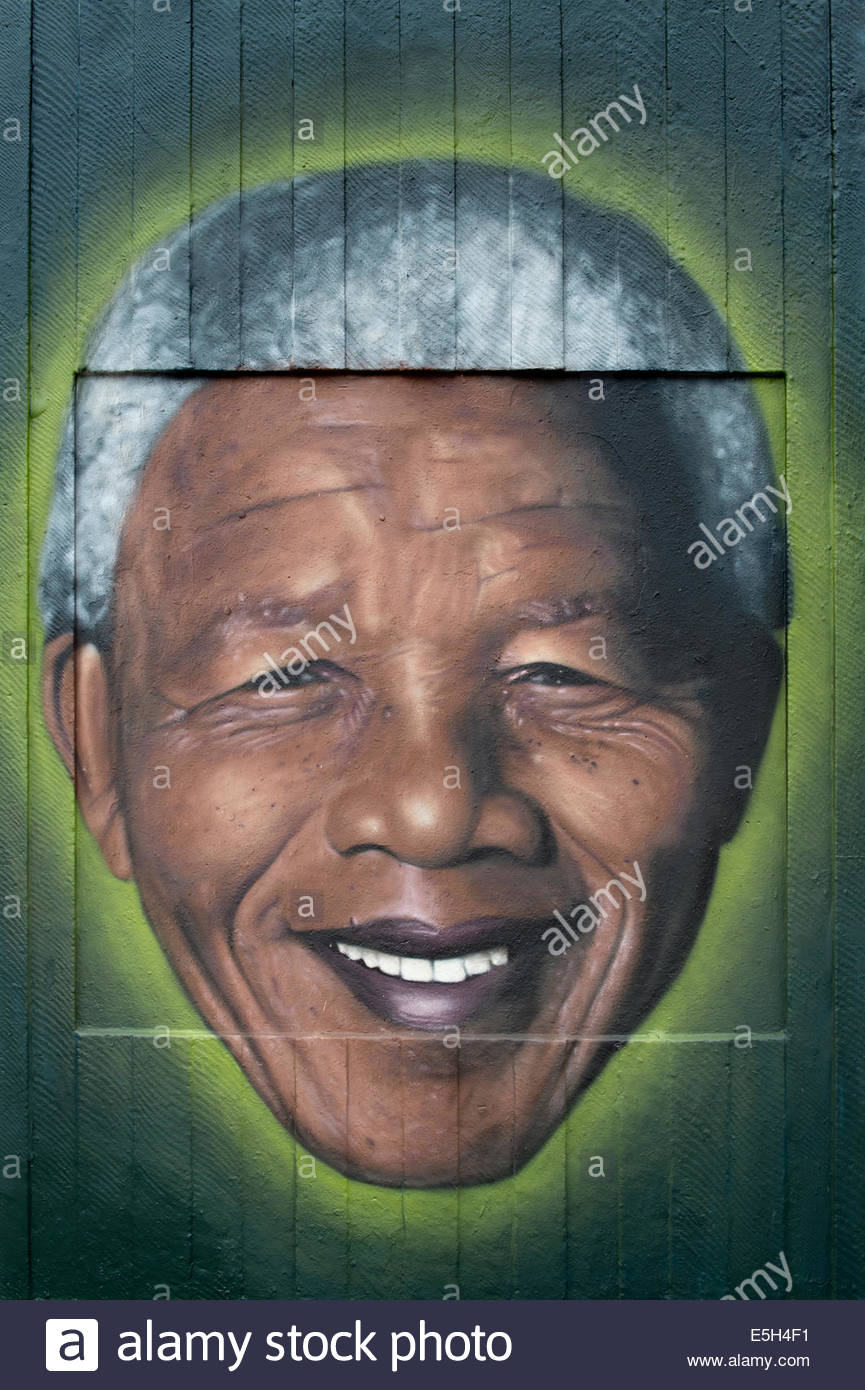 Some Street art representing Nelson Mandela in Stephenson Square in the Northern Quarter area of Manchester city - Stock Image