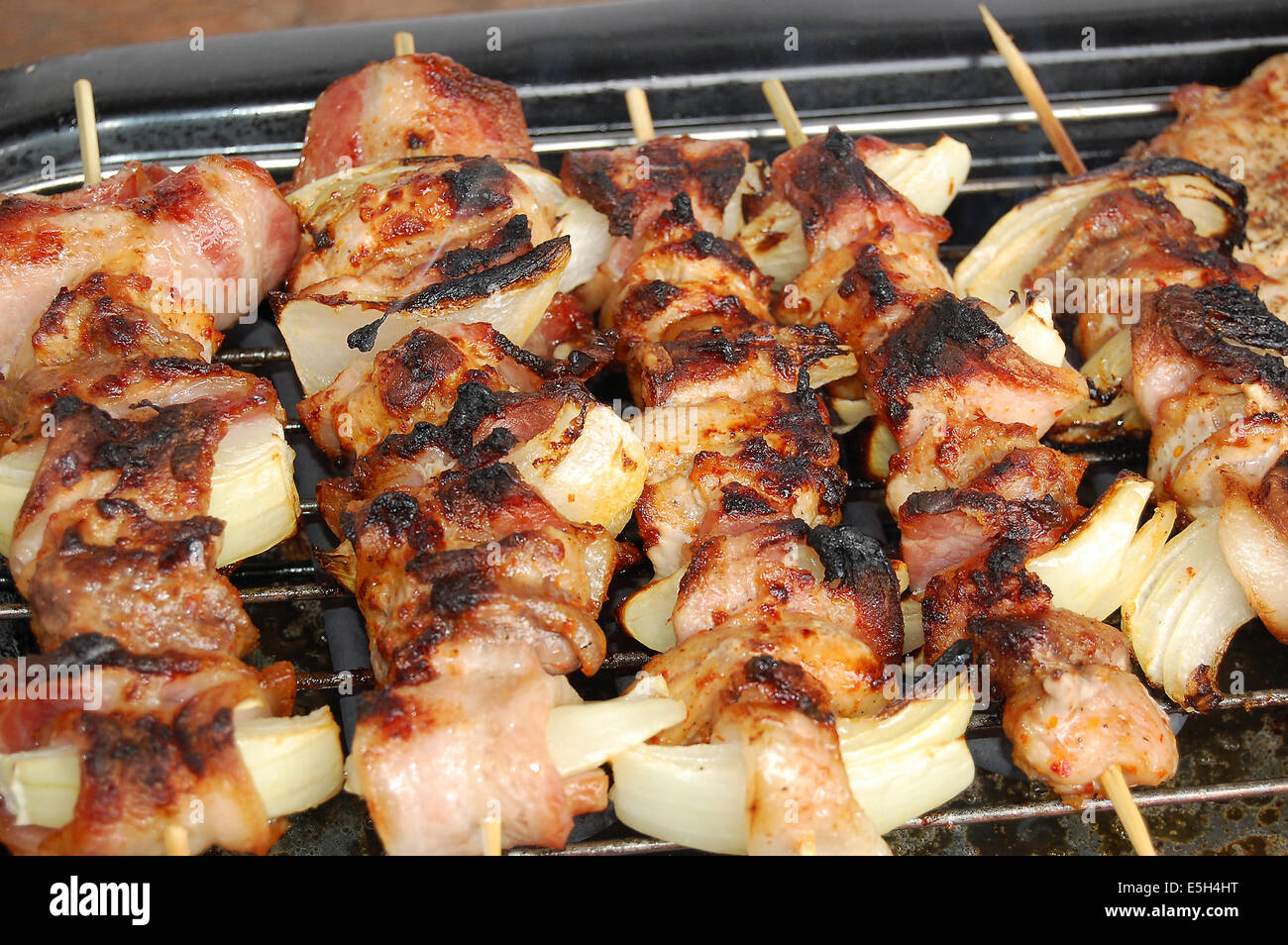 Grilled meat, prepared for a family lunch - Stock Image